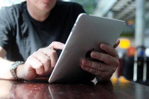 A man using an iPad